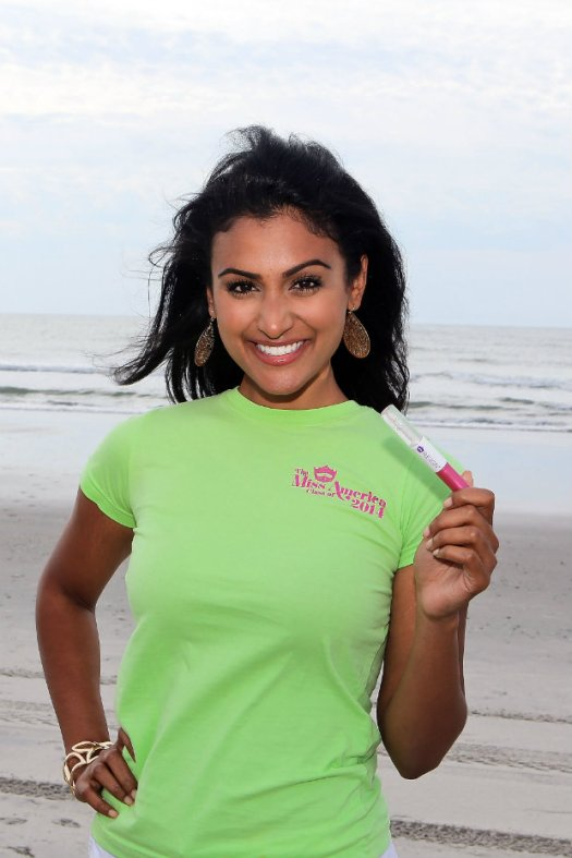 Miss America, Nina Duvalari, takes a dip in the Atlantic After Being Crowned While Wearing R.E.I.G.N. Cosmetics in Atlantic City, NJ