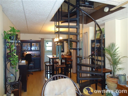 Who doesn't want spiral stairs in the middle of the dining room?