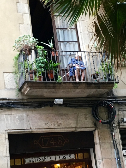 While we ate tapas, this little woman watched everyone pass by from her balcony. Then she fell asleep and kept nodding to the side. I was so worried that she'd fall.